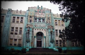 A moldy, mildewy ode to art deco birthday cakes everywhere, my middle school LOOKS like it should be haunted.
