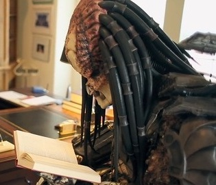 Predator reading a book