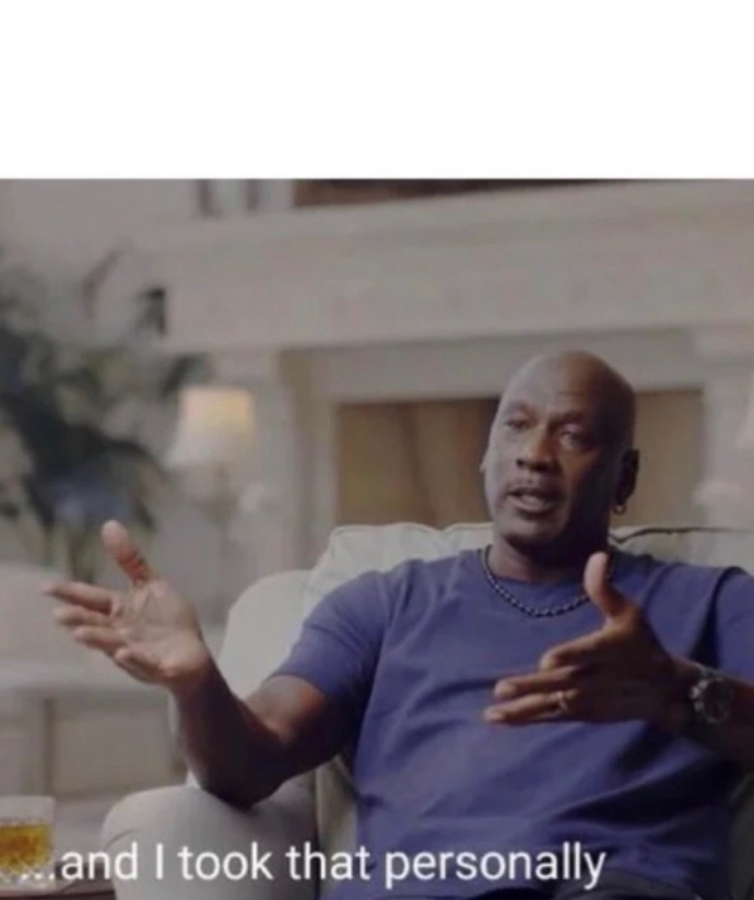 Michael Jordan, sitting in a chair, wearing a blue shirt, saying I took that personally